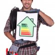 Electrician with an energy rating card — Stock Photo