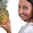 Stock Photo: Womholding fresh pineapple