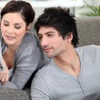 Couple relaxing at hole on their day off — Stock Photo
