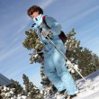Stock Photo: Woman skiing downhill
