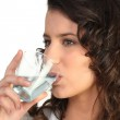 Young woman drinking water — Stock Photo #10839529