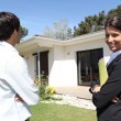 Real estate agent showing a property — Stock Photo