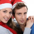 Couple in front of a Christmas tree — Stock Photo #10839884