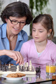 Mother daughter chess match — Stock Photo