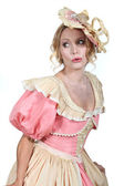 Woman in a theatrical pink and cream dress and bonnet — Stock Photo