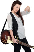 Portrait of a female guitarist — Stock Photo