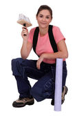 Portrait of a woman about to wallpaper a house — Stock Photo