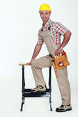 Carpenter stood by work-bench — Stock Photo