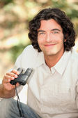 A smiling man with a pair of binoculars — Stock Photo