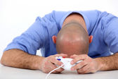 Stressed man playing video game — Stock Photo
