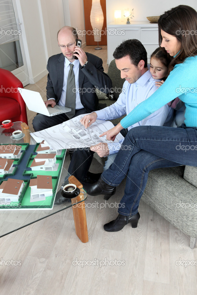 Family consulting with an architect  Stock Photo #10831252