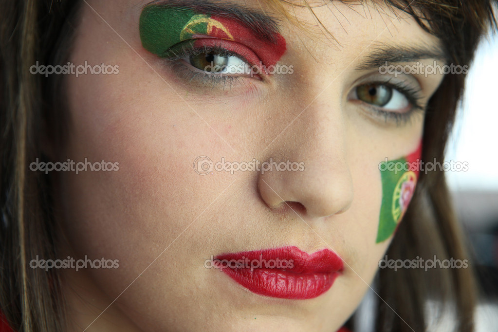 Attractive Portuguese woman with national flag painted on face — Stock Photo #10833436