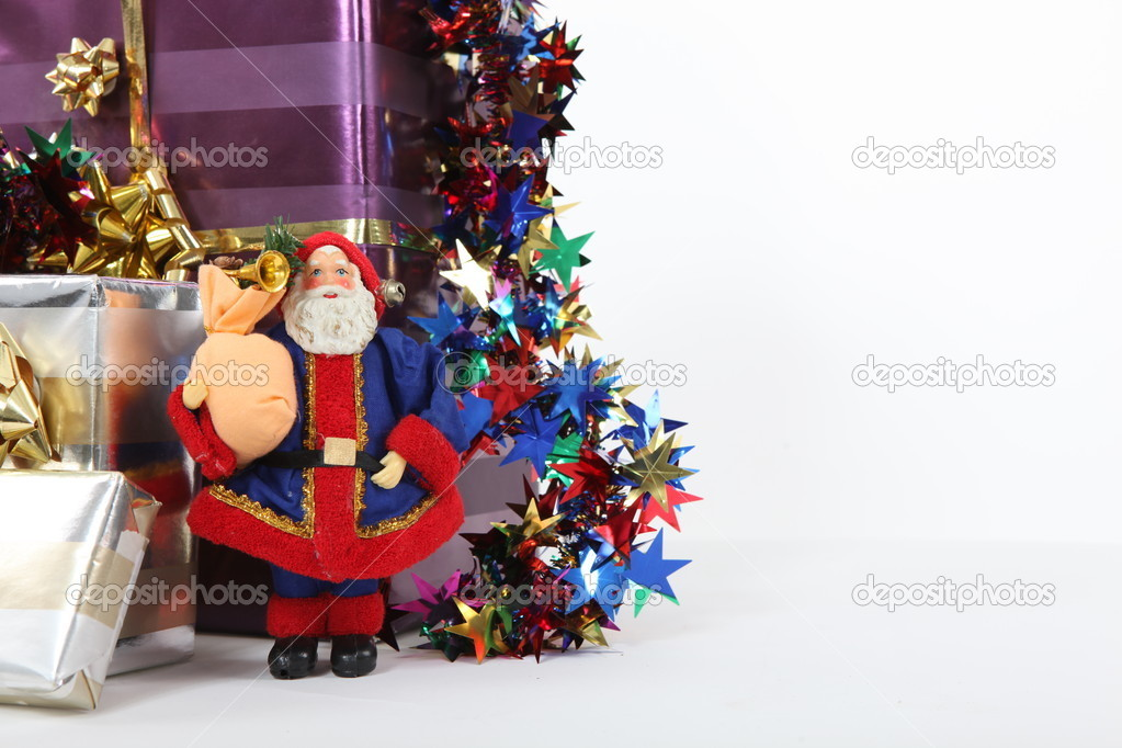 Christmas presents with a model Santa — Foto de Stock   #10834304