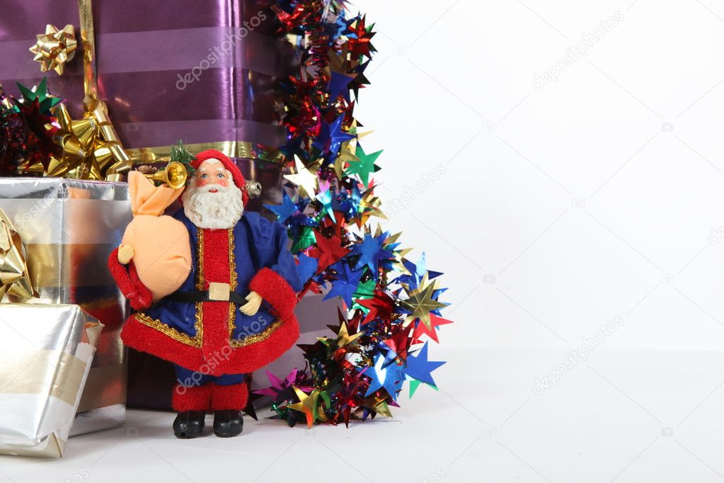 Christmas presents with a model Santa — Stok fotoğraf #10834304