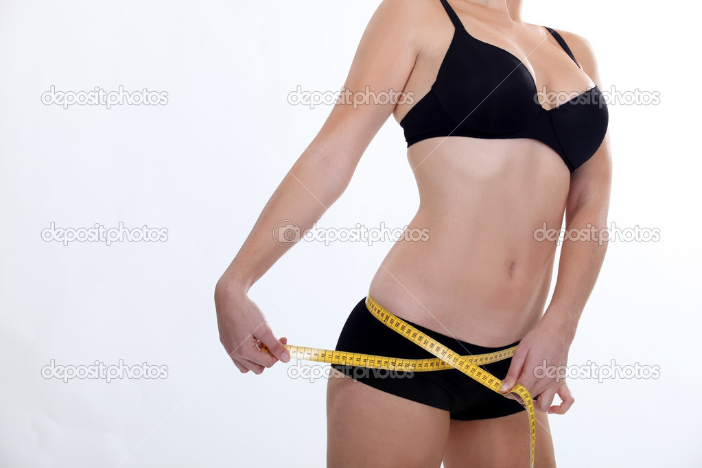 Woman measuring hips — Stock Photo #10836140