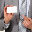 Stock Photo: Cropped picture of businessmshowing his card.
