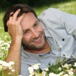 Man lying on grass — Stock Photo