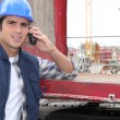 Worker leaning on red beam — Stock Photo #10841546