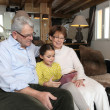 Old couple sat with their granddaughter — Stock Photo #10841575