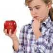Girl with red apple — Stock Photo