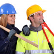 A team of distracted tradespeople - Stock Photo