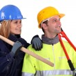Stock Photo: Team of distracted tradespeople