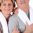 Mature couple resting after fitness - Stock Photo
