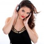 Brunette listening to music through headphones — Stock Photo #10843674
