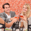 Friends toasting with rose wine — Stock Photo