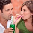 Couple sharing drink — Stock Photo #10844051