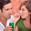 Stock Photo: Couple sharing drink