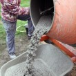 Stock Photo: Craftsmmaking cement