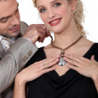 Stock Photo: Husband offering his wife necklace