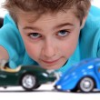 Royalty-Free Stock Photo: Little boy playing with toy cars