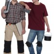 Two male handymen  stood together - Stock Photo