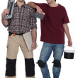 Stock Photo: Two male handymen stood together
