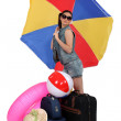 Woman leaving for a warmer climate — Stock Photo #10845438