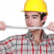 Builder holding measuring tape — Stockfoto #10846886