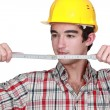 Foto de Stock  : Builder holding measuring tape