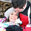 Romantic couple in the snow — Stock Photo