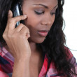 A black woman at phone — Stock Photo #10847332