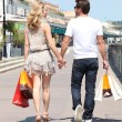 Couple shopping in the street — Stock Photo #10847532