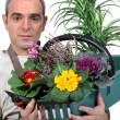 Stock Photo: Florist with his creation
