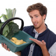 Stock Photo: Man with basket of vegetables