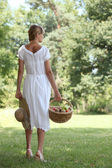 Woman from behind with fruit basket — Stock Photo