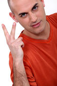 Man holding up two fingers — Stock Photo