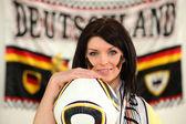Female German soccer supporter stood holding ball — Stock Photo