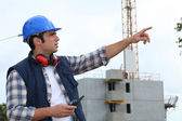 Foreman in charge of large building site — Stok fotoğraf