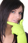 Closeup of a woman wearing household rubber gloves — Stock Photo