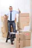 Man surrounded by cardboards — Stock Photo